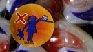 A warning label is attached to a package of Tide laundry detergent packets in Houston on Thursday, May 24, 2012. Canadian authorities are warning people to stop eating laundry detergent pods, a strange and dangerous online trend that has resulted in more than 40 hospitalizations in North America. THE CANADIAN PRESS/AP/Pat Sullivan