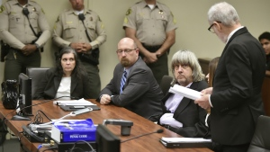 Louise Anna Turpin, far left, with attorney Jeff Moore, second from left, and her husband David Allen Turpin, listen to attorney, David Macher, as they appear in court for their arraignment in Riverside, Calif., Thursday, Jan. 18, 2018. (Frederic J. Brown/Pool Photo via AP)