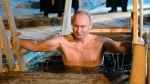 Russian President Vladimir Putin bathes in ice-cold water on Epiphany neat St. Nilus Stolobensky Monastery on Lake Seliger in Svetlitsa village, Russia, Friday, Jan. 19, 2018. (Alexei Druzhinin, Sputnik, Kremlin Pool Photo via AP)