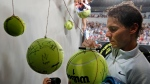 Spain's Rafael Nadal signs autographs after defeating Damir Dzumhur of Bosnia and Herzegovina in their third round match at the Australian Open tennis championships in Melbourne, Australia, Friday, Jan. 19, 2018. (AP Photo/Vincent Thian)