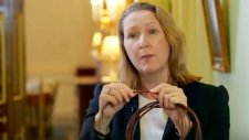 Barbara Welch, director of Buckingham Palace refurbishments, displays old wiring. (YouTube/The Royal Family)