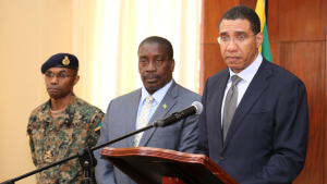 Jamaican Prime Minister Andrew Holness (right) speaks during a news conference announcing  state of emergency in the parish of St. James on Jan. 19, 2018. (Andrew Holness/Twitter)