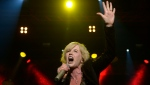 "In this Thursday, Oct. 4, 2012 file photo, Dolores O'Riordan of Irish rock group ""The Cranberries"" perfoms at the Sant Jordi Club in Barcelona, Spain. (AP Photo/Manu Fernandez, File)"