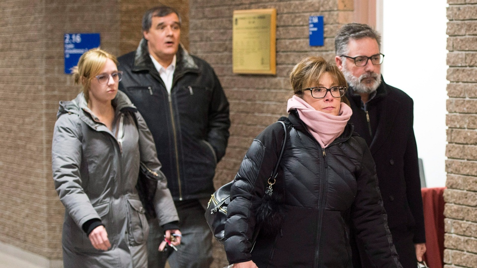 Manager of train operations Jean Demaitre, right, and his wife, Danielle Champagne, are followed by rail traffic controller Richard Labrie, after the end of the sixth day of jury deliberations Tuesday, January 16, 2018 in Sherbrooke, Que. (THE CANADIAN PRESS/Ryan Remiorz)