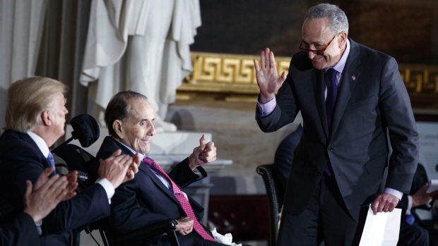 Senate Minority Leader Sen. Chuck Schumer, D-N.Y., right, waves to U.S. President Donald Trump, on Jan. 17, 2018. (Evan Vucci / AP)