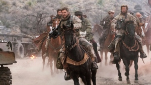 "This image released by Warner Bros. Entertainment shows Geoff Stults, left, and Chris Hemsworth in a scene from ""12 Strong."" (David James/Warner Bros. Entertainment via AP)"
