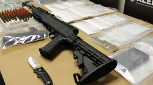 ALERT's Lethbridge Unit arrested a man and seized a high-power rifle during a drug bust on a north end home on Wednesday. (Supplied)