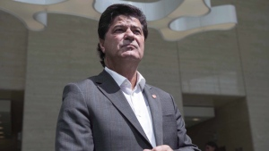 Unifor President Jerry Dias makes his way to speak to the press in Toronto on Friday, August 25, 2017. (THE CANADIAN PRESS/Chris Young)