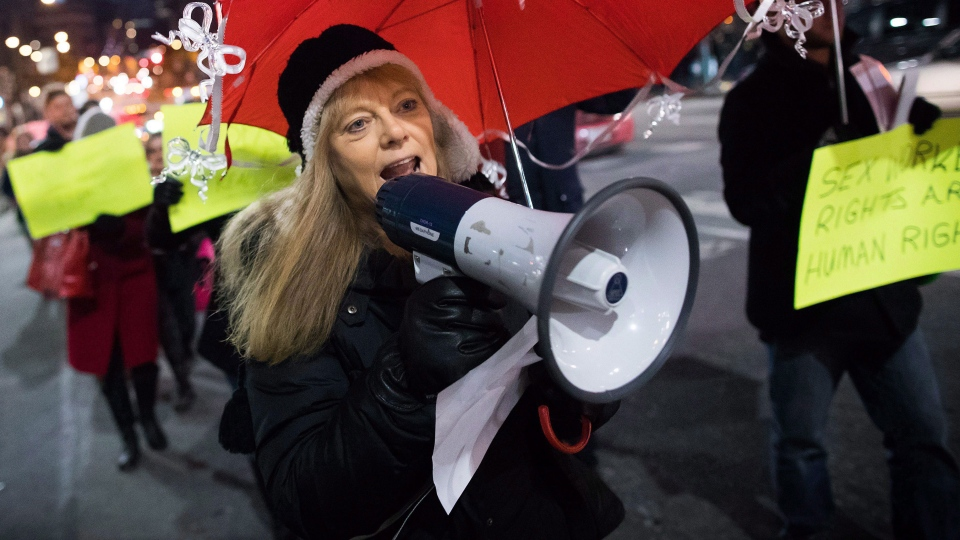 Joyce Arthur leads a red umbrella march to recognize International Day to End Violence Against Sex Workers in the Downtown Eastside of Vancouver, B.C., in this Saturday December 17, 2016 image. THE CANADIAN PRESS/Darryl Dyck