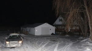 An OPP officer sits in his car in a driveway north of Madoc, Ont., on Thursday January 18, 2018. Months after dismissing growing fears about a potential serial killer prowling Toronto's gay village, police said Thursday they have arrested a man they believe is responsible for the presumed deaths of at least two men who disappeared from the neighbourhood. Bruce McArthur, a 66-year-old Toronto man, was arrested and charged with first-degree murder Thursday morning in the presumed deaths of Selim Esen and Andrew Kinsman, both reported missing from the Church and Wellesley streets area at separate times last year, police said. The men's bodies have not been found, but police said they were combing through five properties - four in Toronto, one in Madoc, Ont. - connected to McArthur, a self-employed landscaper. THE CANADIAN PRESS/Lars Hagberg