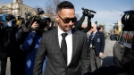 "Michael ""The Situation"" Sorrentino, one of the former stars of the ""Jersey Shore"" reality TV show, is swarmed by reporters while leaving the Martin Luther King, Jr., Federal Courthouse after a hearing, Friday, Jan. 19, 2018, in Newark, N.J. (AP Photo/Julio Cortez)"