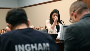Jordyn Wieber gives her victim impact statement in Circuit Judge Rosemarie Aquilina's courtroom Friday, Jan. 19, 2018 during the fourth day of sentencing for former sports doctor Larry Nassar, who pleaded guilty to multiple counts of sexual assault, in Lansing, Mich. (Matthew Dae Smith /Lansing State Journal via AP)