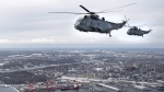 CH-124 Sea King helicopters fly over Halifax on Friday, Jan.19, 2018. (Andrew Vaughan / THE CANADIAN PRESS)