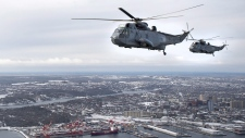 CH-124 Sea King helicopters fly over Halifax