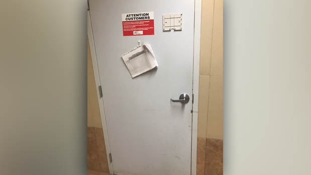 The hinges of the door were on the inside of the washroom door and Cousins said she had no way to remove them. (Source: Crystal Cousins)