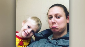 Crystal Cousins is demanding compensation for her 'stress' and 'time' after being stuck with her son for an hour-and-a-half in a Winnipeg Walmart washroom, where she snapped this selfie. (CTV Winnipeg)