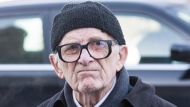 Former sports writer Red Fisher arrives for the funeral of Montreal Canadiens' hockey legend Dickie Moore in Montreal, on Monday, Dec. 28, 2015. THE CANADIAN PRESS/Graham Hughes
