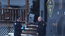 Forensic police officers from the OPP and the Toronto police service stand outside a residence linked to Bruce McArthur in Madoc, Ont., on Friday January 19, 2018. McArthur, a 66-year-old Toronto man, was arrested and charged with first-degree murder in the case of two missing men on Thursday and made a brief appearance in court Friday. He was returned to custody until Feb. 14. THE CANADIAN PRESS/Lars Hagberg.