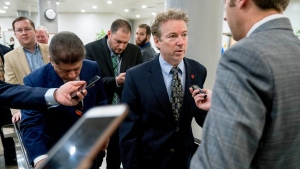 U.S. Sen. Rand Paul, R-Ky., speaks to reporters as he walks towards the Senate as Congress moves closer to the funding deadline to avoid a government shutdown on Capitol Hill in Washington, Thursday, Jan. 18, 2018. (AP Photo/Andrew Harnik)