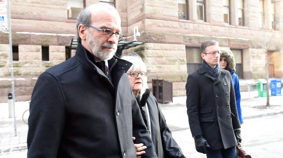 David Livingston leaves court with supporters in Toronto, Friday, Jan.19, 2018. THE CANADIAN PRESS/Nathan Denette