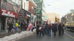 About 40 people marched up the middle of Spring Garden Road in Halifax, N.S., Friday, Jan. 19, 2018.