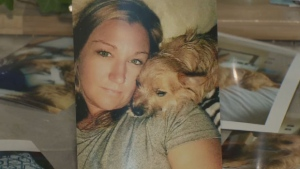 Cindy Beaver is shown is this photo with her dog Tucker. Police believe the yorkie-chihuahua has been killed.