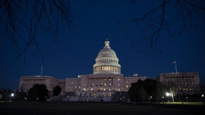 With no apparent indications of a breakthrough in the Senate to avoid a government shutdown, the Capitol is illuminated in Washington, Friday evening, Jan. 19, 2018. (AP Photo / J. Scott Applewhite)