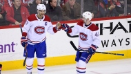 Montreal Canadiens left wing Max Pacioretty (67) celebrates his goal with left wing Paul Byron (41) during the third period of an NHL hockey game against the Washington Capitals, Friday, Jan. 19, 2018, in Washington. The Canadiens won 3-2. (AP Photo/Nick Wass)