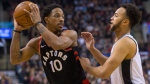 Toronto Raptors guard DeMar DeRozan (10) looks to make a pass around San Antonio Spurs forward Kyle Anderson (1) during second half NBA basketball action in Toronto on Friday, January 19, 2018. THE CANADIAN PRESS/Chris Young