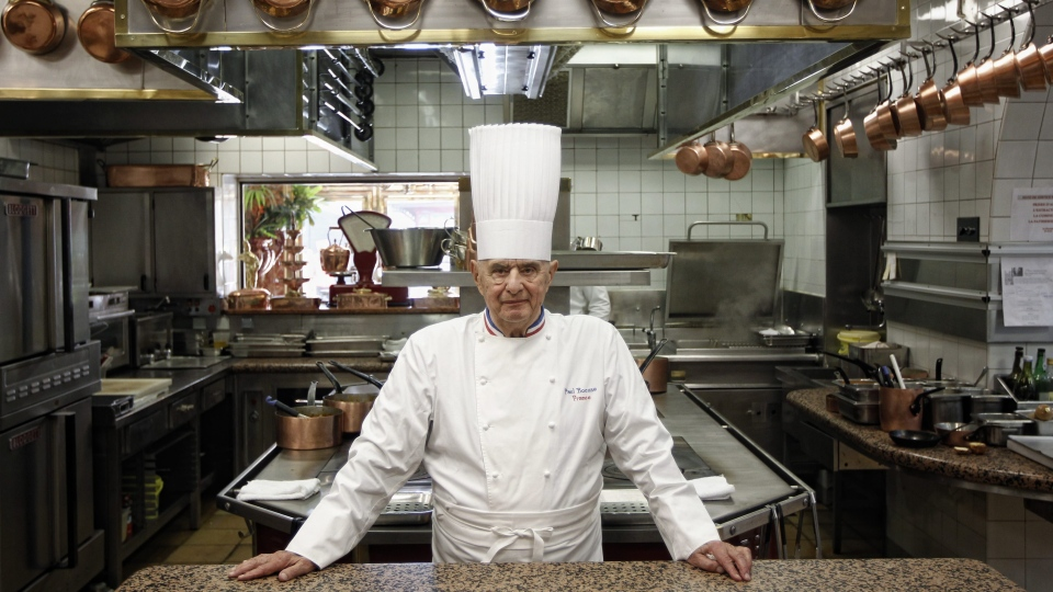 In this March 24, 2011 file French Chef Paul Bocuse poses outside his famed Michelin three-star restaurant L'Auberge du Pont de Collonges in Collonges-au-Mont-d'or, central France. (AP Photo/Laurent Cipriani, File)