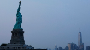 In this Tuesday, July 7, 2015, file photo, the Statue of Liberty stands in New York harbour with the New York City skyline in the background. (Kathy Willens/AP Photo)