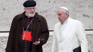 FILE - In this Feb. 13, 2015 file photo, Pope Francis, right, talks with the head of a sex abuse advisory commission, Cardinal Sean Patrick O'Malley, of Boston, as they arrive for a special consistory in the Synod hall at the Vatican. (AP Photo/Andrew Medichini, File)