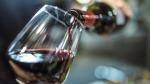 Red wine is poured into a glass in this file photo. (Instants / Istock.com)