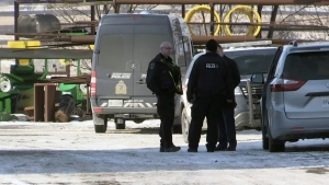 Police investigate after a child was found dead at a farm on Ament Line near Linwood on Saturday, Jan. 20, 2018.