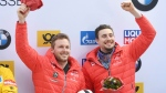 Justin Kripps, left, and Alexander Kopacz of Canada celebrate their third place in the two-men bob World Cup in Koenigssee, Germany, Saturday, Jan. 20, 2018. (Tobias Hase/dpa via AP)