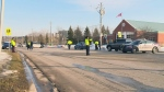 Emergency crews block off a section of Pioneer Drive in Kitchener after a man was hit by a vehicle on Saturday, Jan. 20, 2018.