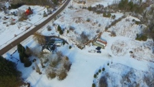 Police search a rural property in Madoc, Ont.