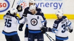Winnipeg Jets' Bryan Little (18) celebrates a goal with teammates Mathieu Perreault (85), Dustin Byfuglien (33) and Toby Enstrom (39) during the second period of their NHL hockey game against the Calgary Flames in Calgary, Alta., on Saturday, Jan. 20, 2018. (THE CANADIAN PRESS/Todd Korol)