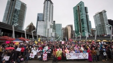 Thousands of people attend a women's march in Vancouver, B.C., on Saturday January 20, 2018. (THE CANADIAN PRESS/Darryl Dyck)