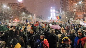 Protesters block a main boulevard during a protest in Bucharest, Romania, Saturday, Jan. 20, 2018. (AP Photo/Vadim Ghirda)