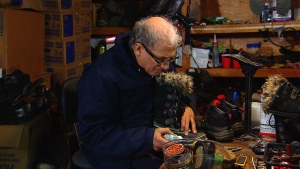 Father Jean-Pierre Couturier fixes boots for the homeless, in Montreal.