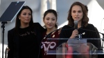 Actress Natalie Portman, right, speaks as she is joined by Eva Longoria, background left, and Constance Wu at a Women's March against sexual violence and the policies of the Trump administration Saturday, Jan. 20, 2018, in Los Angeles. (AP Photo / Jae C. Hong)
