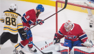 Boston Bruins' David Pastrnak (88) scores against Montreal Canadiens goaltender Carey Price as Canadiens' Jordie Benn defends during third period NHL hockey action in Montreal, Saturday, January 20, 2018. THE CANADIAN PRESS/Graham Hughes