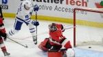 Toronto Maple Leafs centre Mitchell Marner (16) slips the puck past Ottawa Senators' goaltender Craig Anderson during third period NHL action in Ottawa, Saturday, Jan.20, 2018. (THE CANADIAN PRESS/Adrian Wyld)