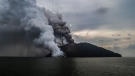 In this photo provided by Brenton-James Glover, ash plumes rise from the volcano on Kadovar Island, Papua New Guinea in the South Pacific Sunday, Jan. 21, 2018. (Brenton-James Glover via AP)