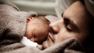A father is shown with his newborn in this file photo. (Pexels / Pixabay)