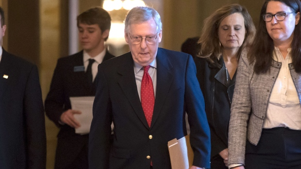 U.S. Senate Majority Leader Mitch McConnell, R-Ky., walks to the chamber on the first morning of a government shutdown after a divided Senate rejected a funding measure last night, at the Capitol in Washington, Saturday, Jan. 20, 2018. (AP Photo/J. Scott Applewhite)