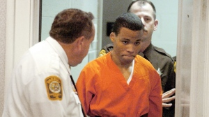 Lee Boyd Malvo enters a courtroom in the Spotsylvania, Va., Circuit Court on Oct. 26, 2004. (Mike Morones/The Free Lance-Star)