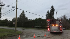 Emergency crews attend to downed wires at West 2nd Avenue and Blanca Street in Vancouver.