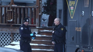 Forensic police officers from the OPP and the Toronto police service stand outside a residence linked to Bruce McArthur in Madoc, Ont., on Friday January 19, 2018. (THE CANADIAN PRESS/Lars Hagberg)